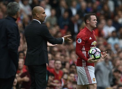 Pep Guardiola and Wayne Rooney