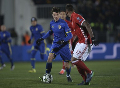 Rostov's Dmitri Poloz, left, controls a ball next to Bayern's Jerome Boateng.