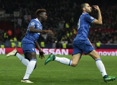 Juventus' Leonardo Bonucci, right, and Juventus' Moise Kean celebrate.