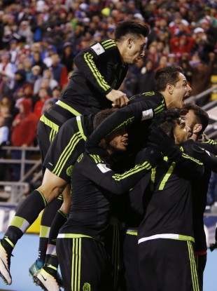 Mexico players celebrate their winning goal against the United States.