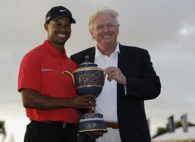 Tiger Woods stands with Donald Trump as he holds the Gene Serazen Cup for winning the Cadillac Championship golf tournament in 2013.