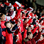 Cuala's band of colourful and noisy fans cheer their team on.<span class=