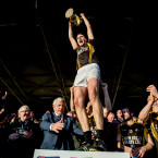 Damien Burke rises as a provincial champion with Ballyea.<span class=