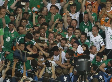 Robbie Brady, centre, celebrates with supporters at the end of the Euro 2016 Group E soccer match between Italy and Ireland at the Pierre Mauroy stadium in Villeneuve near Lille.