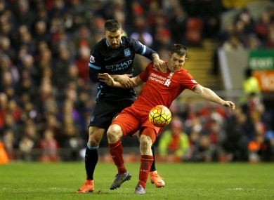 Liverpool's James Milner (right) and Manchester City's Aleksandar Kolarov battle for the ball during last season's match between the teams at Anfield.