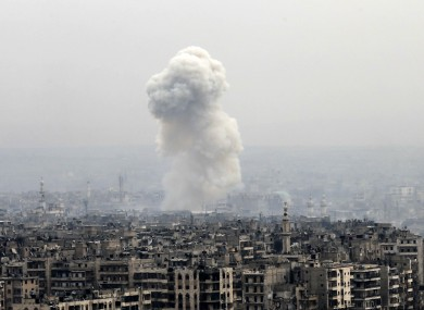 Smoke rises following an air strike on insurgents positions in eastern Aleppo on Monday,