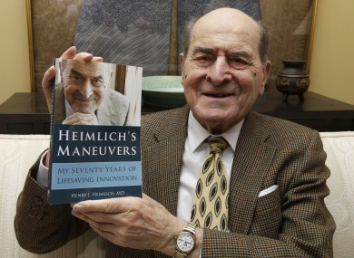 Dr. Henry Heimlich holds his memoirs prior to being interviewed at his home in Cincinnati in 2014.