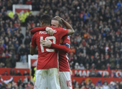 The man to beat: Rashford and Rooney celebrate after the FA Cup win over Reading.