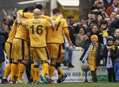Sutton's players celebrate the goal of Jamie Collins.
