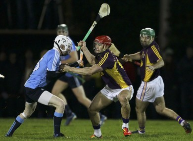 Wexfor's Lee Chin (right) and Dublin's Fiontán Mac Gib battle for possession.