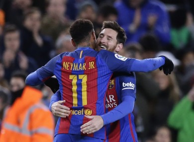 Barcelona's Lionel Messi, right, celebrates with Neymar after scoring a free-kick.