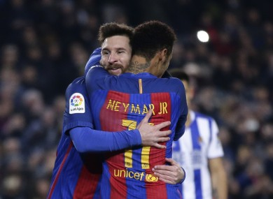 Lionel Messi, left, celebrates with his team mate Neymar after scoring a penalty.