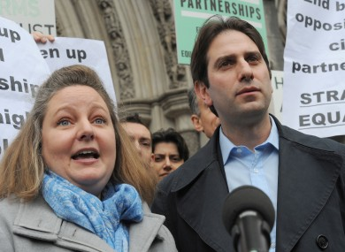 Rebecca Steinfeld and Charles Keidan outside the Royal Courts of Justice in London.