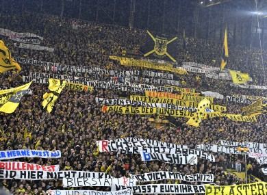 Dortmund fans display banners protesting against RB Leipzig.