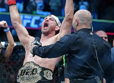 Stipe Miocic celebrates after last September's successful title defence against Alistair Overeem.