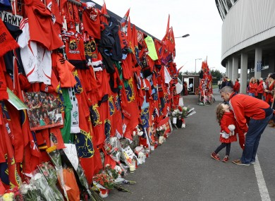 Munster fans pictured at a tribute wall to Anthony Foley at Thomond Park, Limerick.