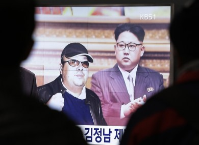 A TV screen shows pictures of North Korean leader Kim Jong Un and his older brother Kim Jong Nam.