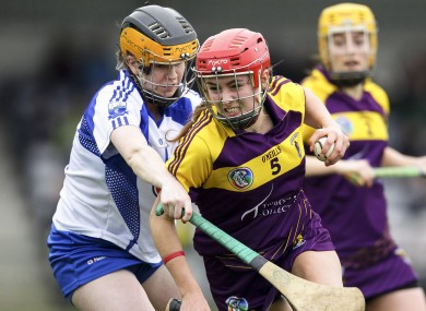 Wexford's Sarah O'Connor is tackled by Waterford's Catriona McGlone.