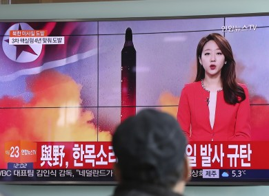 A man watches a TV news program reporting about North Korea's missile at the Seoul Train Station, South Korea.