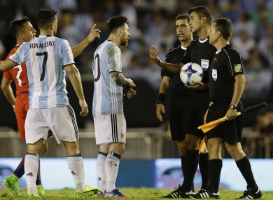 Messi arguing with referee Sandro Ricci and his assistants.