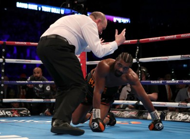 David Haye is counted down by referee Phil Edwards after being knocked down by Tony Bellew.