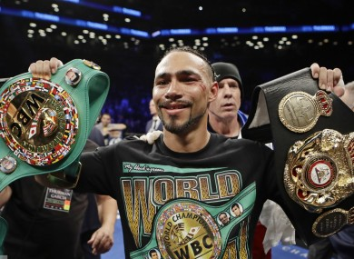 Thurman poses with his belts.
