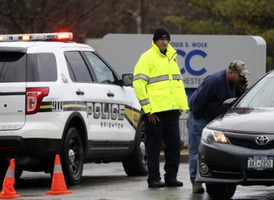 Police officers investigate a bomb threat outside the Louis S. Wolk Jewish Community Center of Greater Rochester in Brighton.