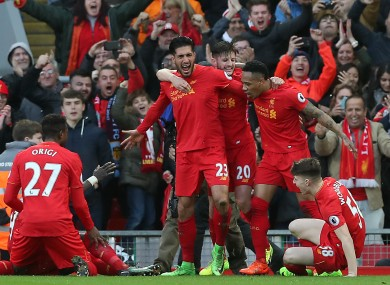 Liverpool celebrating Can's winning goal.