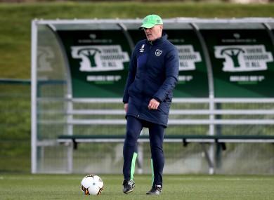 Keane kicks a ball during Ireland's training session.