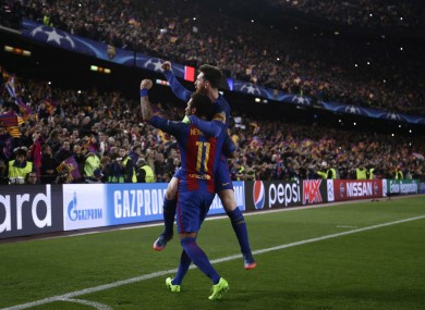 Barcelona's Lionel Messi celebrates with Neymar following their victory at the end of the Champion League round of 16.