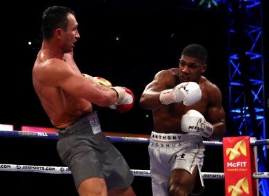 Anthony Joshua (right) competing against Wladimir Klitschko during their IBF, WBA and IBO Heavyweight World Title bout at Wembley Stadium.