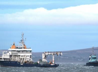 The Granuaile (left) alongside the tug Ocean Challenger during an earlier search.