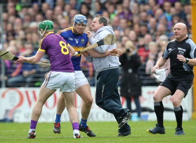 Davy Fitzgerald and Jason Forde clash in the hurling league semi-final.