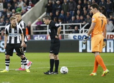 Matt Ritchie voices his disgust with referee Keith Stroud.