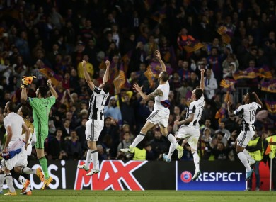 Juventus players celebrate at the end of the Champions League quarter-final second leg.
