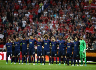 Manchester United players show their respects to the victims of the Manchester terror attack before the UEFA Europa League Final at the Friends Arena in Stockholm.