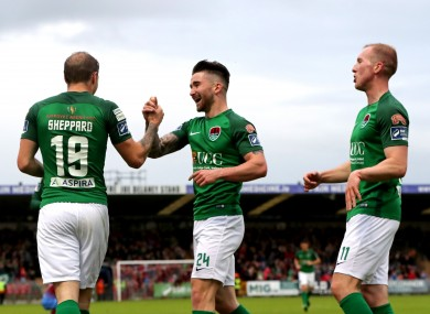Karl Sheppard, Sean Maguire and Stephen Dooley celebrate after Sheppard scored Cork City's third goal.