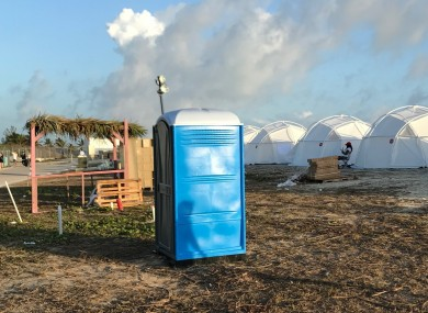 Tents and a portable toilet set up for attendees for the cancelled Fyre Festival.