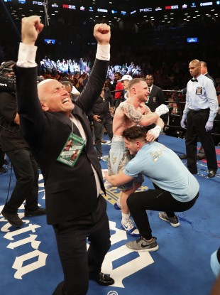 Barry and Shane McGuigan celebrate with Carl Frampton after his win over Leo Santa Cruz.