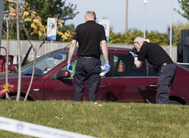 Gardaí examine Gatley's car after the shooting.