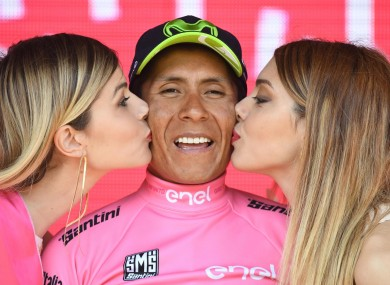 Colombian rider Nairo Quintana wears the pink jersey of the overall leader.