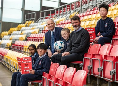 Roy Keane, pictured with Minister of State in the Department of Justice and Equality David Stanton and some school children, was speaking at a Show Racism the Red Card event yesterday.