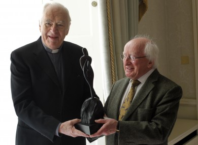 President Michael D Higgins iss presented with the Father Aengus Finucane Award for Services to Humanity by Concern Worldwide by Father Jack Finucane.