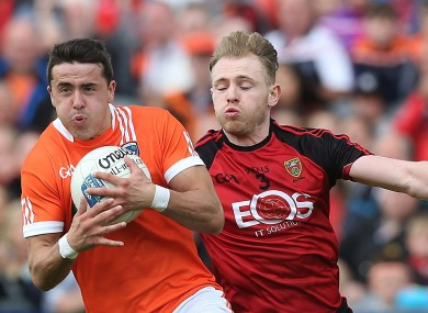 Down's Gearard McGovern with Stefan Campbell of Armagh.