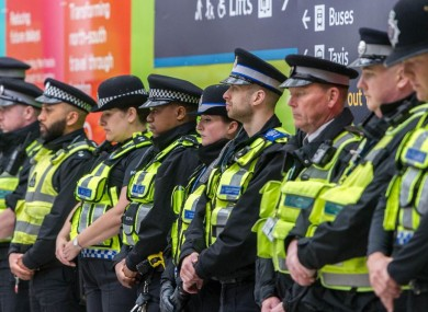 Police officers hold a minute's silence at London Bridge Station