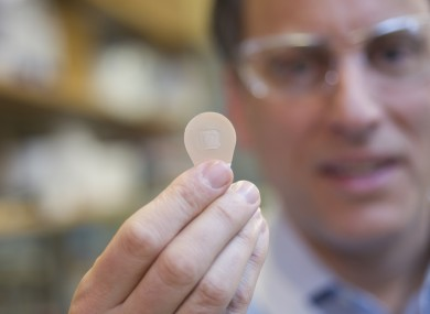 Prof Mark Prausnitz of Georgia Tech holds a microneedle patch.