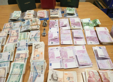 A stock photo of cash and jewelry seized by CAB in raids last year.