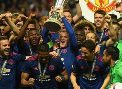 Wayne Rooney lifts the Europa League trophy.