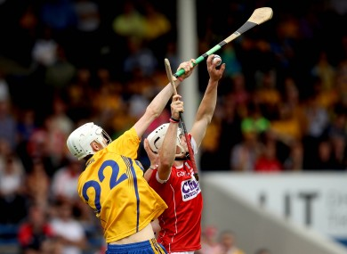 Cork full-back Sean O'Leary Hayes catches the ball over Clare's Colin Haugh.
