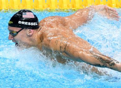 Dressel: won three golds in 98 minutes on Saturday night.
